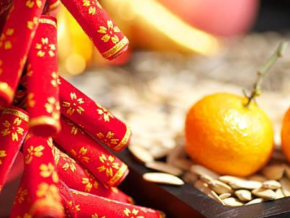 photo of oranges and Chinese decorations